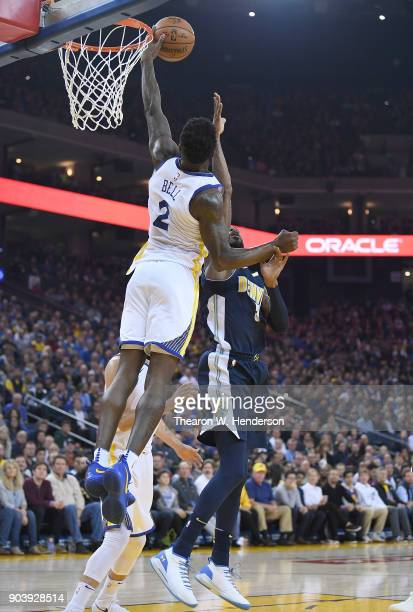 Jordan Bell of the Golden State Warriors goes up to block the shot of Will Barton of the Denver Nuggets during an NBA Basketballl game at ORACLE...