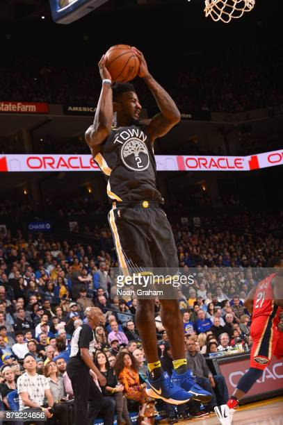 Jordan Bell of the Golden State Warriors grabs the rebound against the New Orleans Pelicans on November 25 2017 at ORACLE Arena in Oakland California...