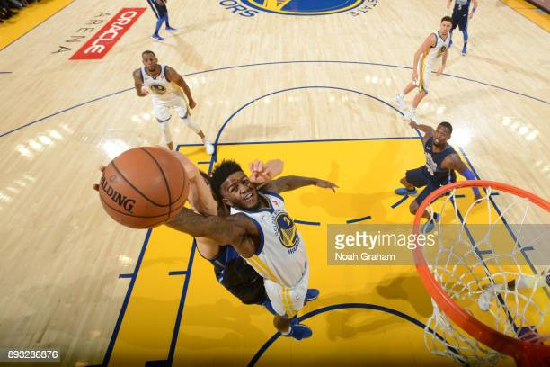 Jordan Bell of the Golden State Warriors grabs the rebound against the Dallas Mavericks on December 14 2017 at ORACLE Arena in Oakland California...