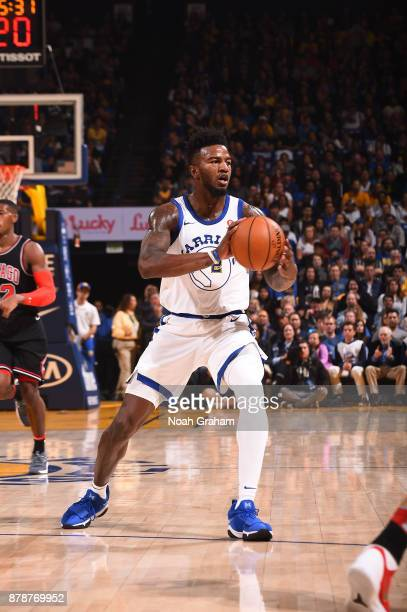 Jordan Bell of the Golden State Warriors handles the ball against the Chicago Bulls on November 24 2017 at ORACLE Arena in Oakland California NOTE TO...