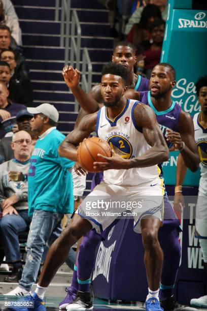 Jordan Bell of the Golden State Warriors handles the ball against the Charlotte Hornets on December 6 2017 at Spectrum Center in Charlotte North...