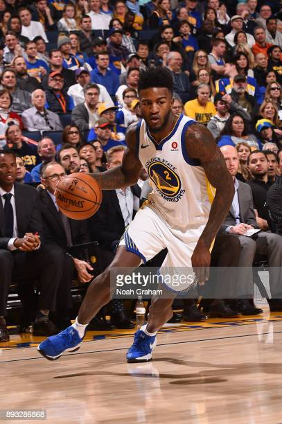 Jordan Bell of the Golden State Warriors handles the ball against the Dallas Mavericks on December 14 2017 at ORACLE Arena in Oakland California NOTE...