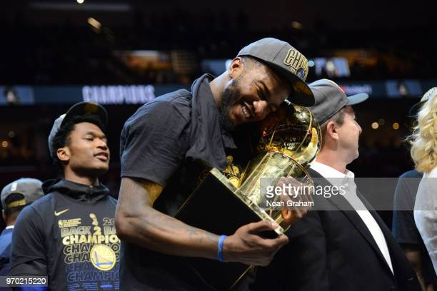 Jordan Bell of the Golden State Warriors holds Larry O'Brien Championship Trophy after the game against the Cleveland Cavaliers during Game Four of...