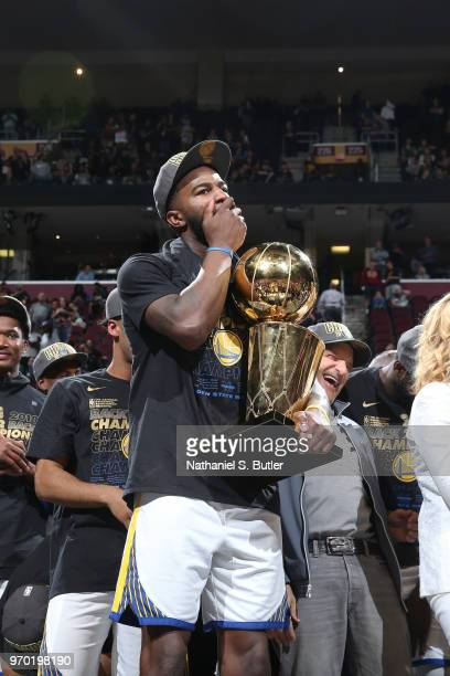 Jordan Bell of the Golden State Warriors holds the Larry O'Brien Championship Trophy after Game Four of the 2018 NBA Finals against the Cleveland...