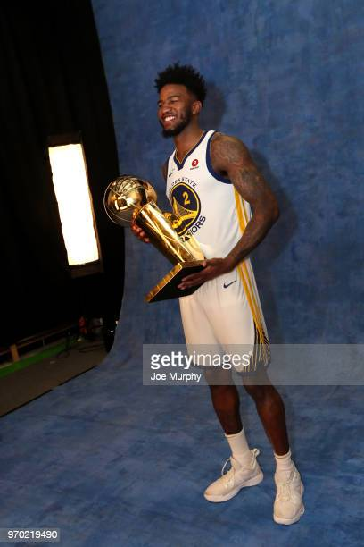OH Jordan Bell of the Golden State Warriors poses for a portrait with the Larry O'Brien Championship trophy after defeating the Cleveland Cavaliers...
