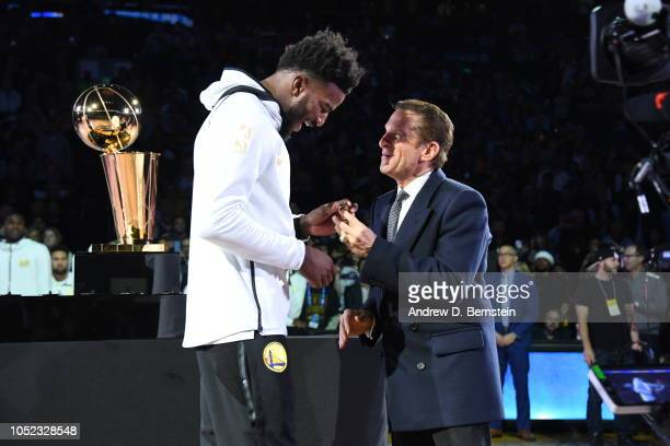 Jordan Bell of the Golden State Warriors receives his 2018 NBA finals Championship ring from Owner Peter Guber on October 16 2018 at ORACLE Arena in...