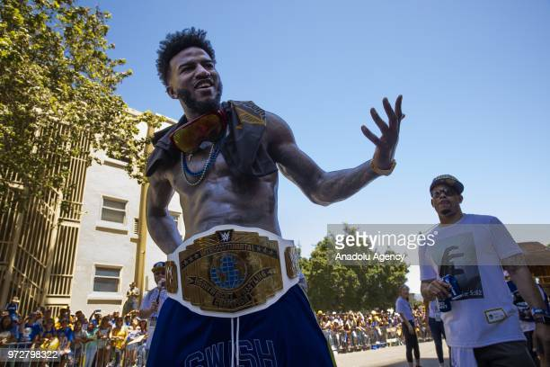 Jordan Bell of the Golden State Warriors wears a wrestling championship belt he received from a fan as he interacts with the crowd during the Golden...