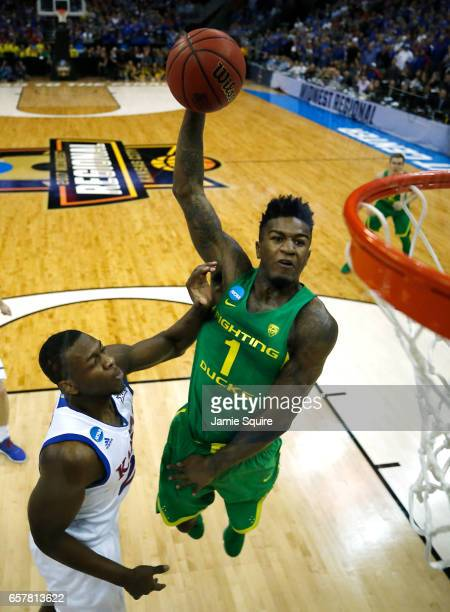 Jordan Bell of the Oregon Ducks attempts to dunks the ball past Lagerald Vick of the Kansas Jayhawks during the 2017 NCAA Men's Basketball Tournament...
