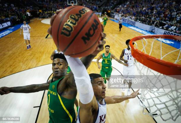 Jordan Bell of the Oregon Ducks defends a shot by Landen Lucas of the Kansas Jayhawks in the second half during the 2017 NCAA Men's Basketball...