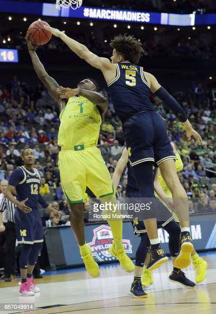 Jordan Bell of the Oregon Ducks drives to the basket against DJ Wilson of the Michigan Wolverines in the first half during the 2017 NCAA Men's...