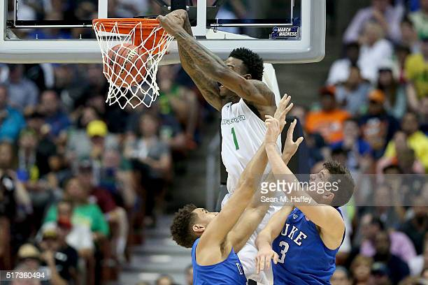 Jordan Bell of the Oregon Ducks dunks the ball against Chase Jeter and Grayson Allen of the Duke Blue Devils in the first half in the 2016 NCAA Men's...