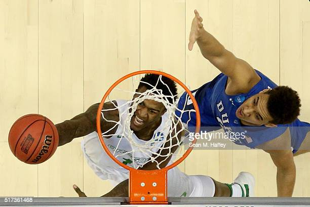 Jordan Bell of the Oregon Ducks goes up for a shot against Chase Jeter of the Duke Blue Devils in the first half in the 2016 NCAA Men's Basketball...