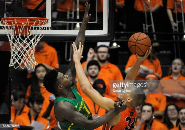 Jordan Bell of the Oregon Ducks goes up to try and block the shot of Ben Kone of the Oregon State Beavers during the first half of the game at Gill...
