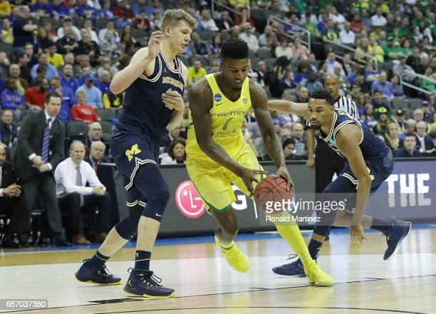 Jordan Bell of the Oregon Ducks is defended by Moritz Wagner of the Michigan Wolverines during the 2017 NCAA Men's Basketball Tournament Midwest...