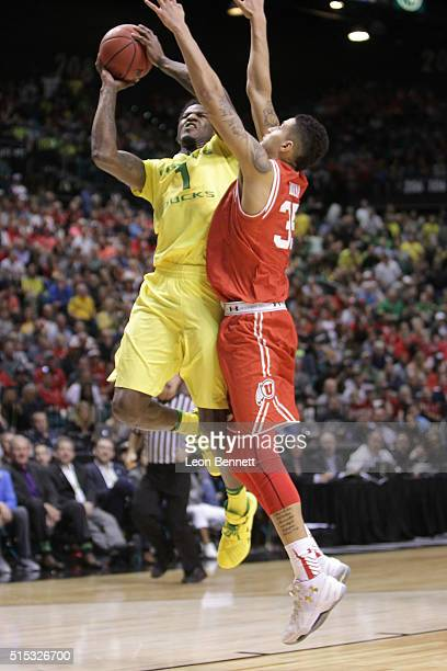 Jordan Bell of the Oregon Ducks shoots the ball for two over Kyle Kuzma of the Utah Utes during the championship game of the Pac12 Basketball...