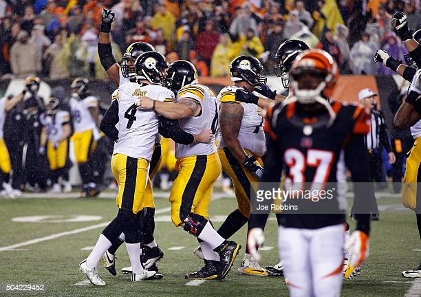 Jordan Berry of the Pittsburgh Steelers celebrates with teammates after Chris Boswell made a 35-yard field goal to give the Pittsburgh Steelers a...