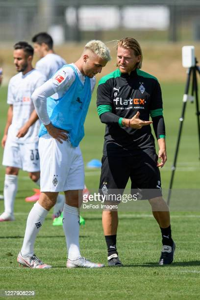 Jordan Beyer of Borussia Moenchengladbach and Talentmanager Eugen Polanski of Borussia Moenchengladbach discuss during the first training session...