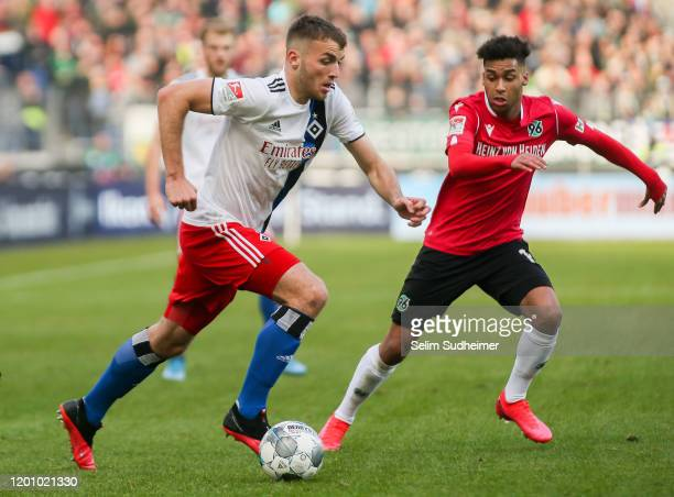 Jordan Beyer of Hamburger SV fights for the ball with Linton Maina of Hannover 96 during the Second Bundesliga match between Hannover 96 and...