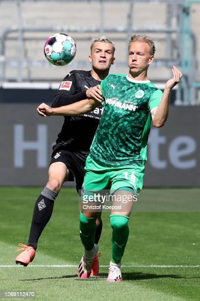 Jordan Beyer of Moenchengladbach challenges Havard Nielsen of Fuerth during the pre-season friendly match between Borussia Monechengladbach and SpVGG...