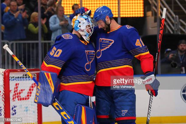 Jordan Binnington and Robert Bortuzzo of the St Louis Blues celebrate after beating the Calgary Flames at Enterprise Center on November 21 2019 in St...