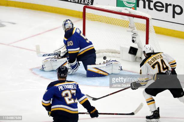 Jordan Binnington of the St Louis Blues allows a third period goal to Brandon Carlo of the Boston Bruins in Game Six of the 2019 NHL Stanley Cup...