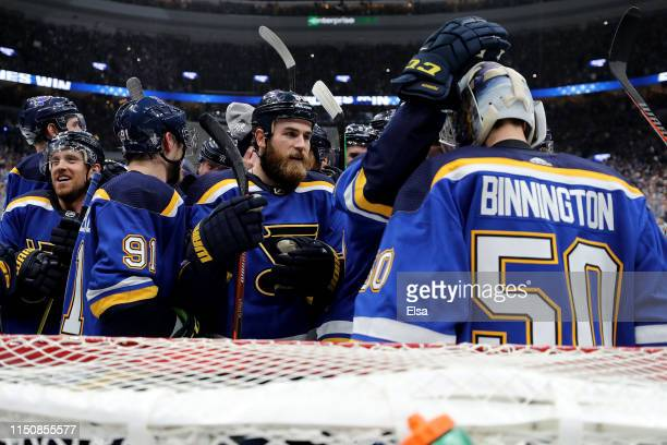 Jordan Binnington of the St. Louis Blues celebrates with his teammates after defeating the San Jose Sharks in Game Six with a score of 5 to 1 to win...