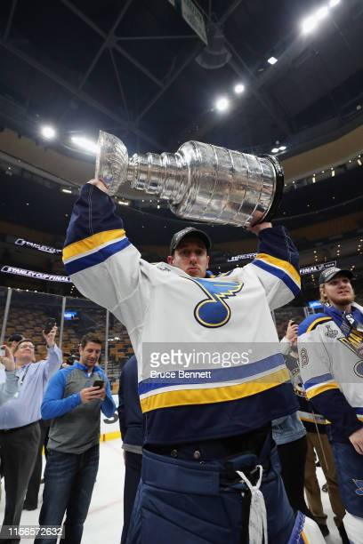 Jordan Binnington of the St Louis Blues holds the Stanley Cup following the Blues victory over the Boston Bruins at TD Garden on June 12 2019 in...