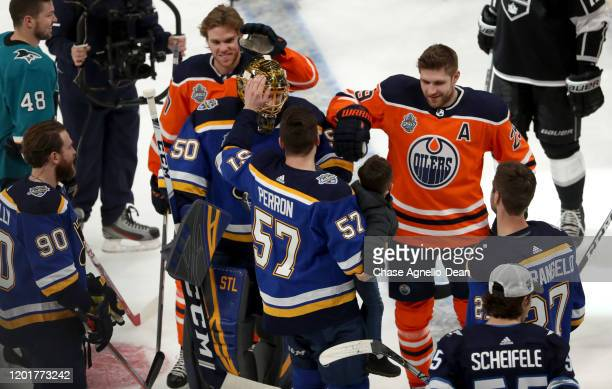 Jordan Binnington of the St Louis Blues is congratulated by his Western Conference teammates after competing in the Bud Light NHL Save Streak event...