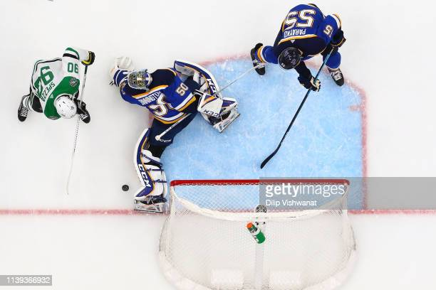 Jordan Binnington of the St Louis Blues makes a save against Jason Spezza of the Dallas Stars as Colton Parayko of the St Louis Blues defends in Game...