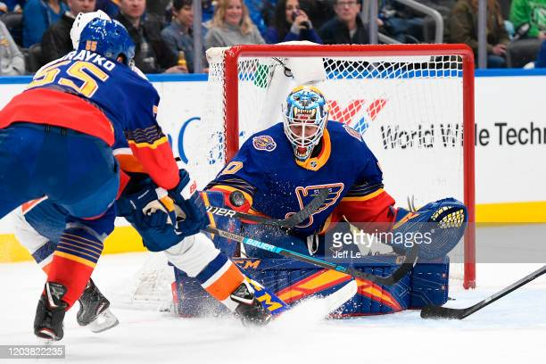 Jordan Binnington of the St Louis Blues makes a save against the New York Islanders at Enterprise Center on February 27 2020 in St Louis Missouri