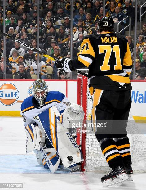 Jordan Binnington of the St Louis Blues makes a save infant of Evgeni Malkin of the Pittsburgh Penguins at PPG Paints Arena on March 16 2019 in...