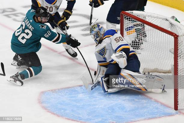 Jordan Binnington of the St Louis Blues makes a save on a shot by Kevin Labanc of the San Jose Sharks in Game Five of the Western Conference Final...