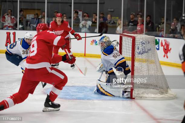 Jordan Binnington of the St. Louis Blues makes first period save on Anthony Mantha of the Detroit Red Wings during a pre-season Kraft Hockeyville...