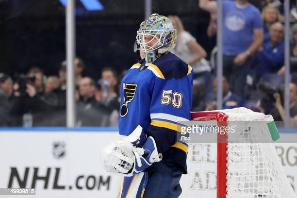 Jordan Binnington of the St Louis Blues reacts after making a save against Melker Karlsson of the San Jose Sharks during the first period in Game...