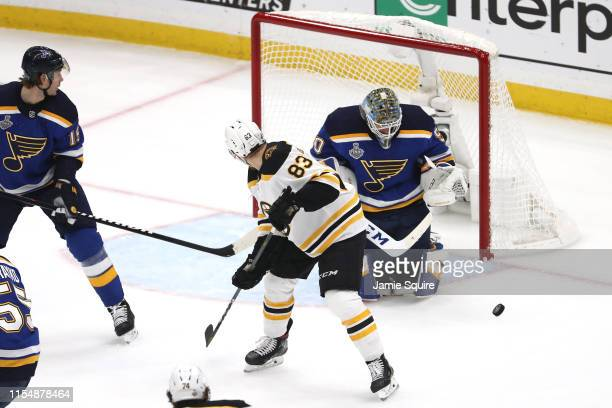 Jordan Binnington of the St Louis Blues stops a shot against Karson Kuhlman of the Boston Bruins during the first period in Game Six of the 2019 NHL...