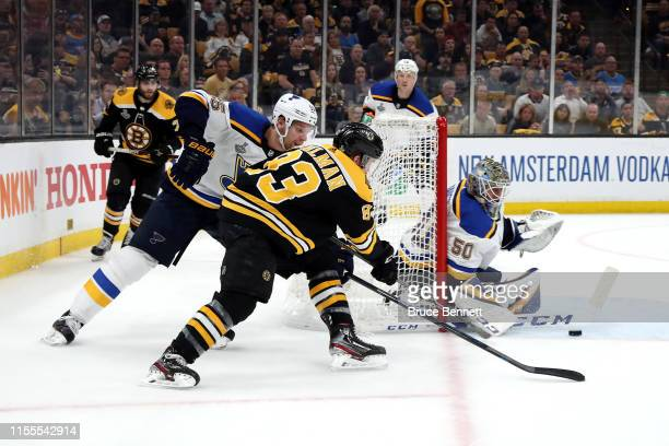Jordan Binnington of the St Louis Blues stops a shot against Karson Kuhlman of the Boston Bruins during the second period in Game Seven of the 2019...