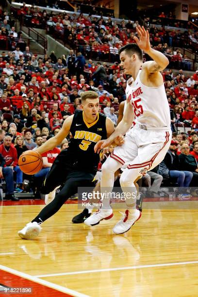 Jordan Bohannon of the Iowa Hawkeyes attempts to drive past Kyle Young of the Ohio State Buckeyes during the game at Value City Arena on February 10...