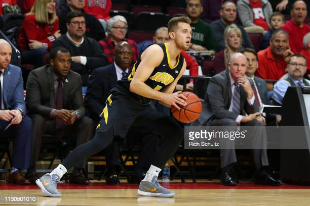 Jordan Bohannon of the Iowa Hawkeyes in action against the Rutgers Scarlet Knights during a game at Rutgers Athletic Center on February 16 2019 in...