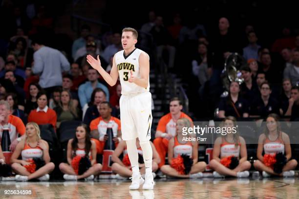 Jordan Bohannon of the Iowa Hawkeyes reacts after making a three point basket in the second half against the Illinois Fighting Illini during the Big...