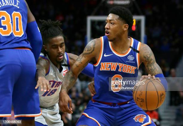 Jordan Bone of the Detroit Pistons tries to stay with Elfrid Payton of the New York Knicks during the first half at Little Caesars Arena on February...