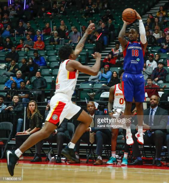 Jordan Bone of the Grand Rapids Drive shoots against Armoni Brooks of the College Park Skyhawks during the second half of an NBA GLeague game on...