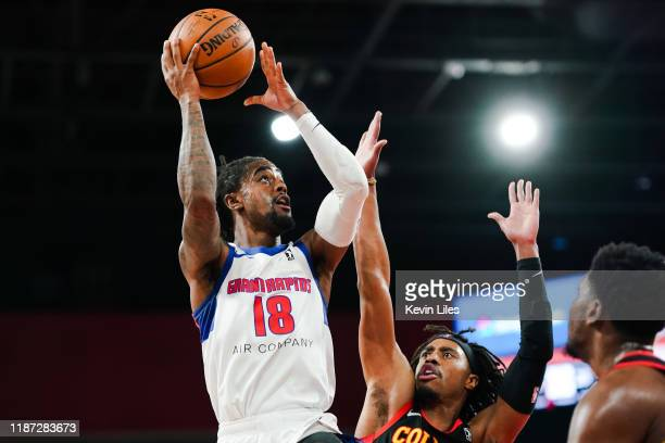 Jordan Bone of the Grand Rapids Drive shoots over Tahjere McCall of the College Park Skyhawks during the second quarter an NBA GLeague game on...