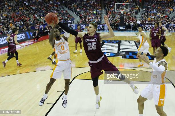 Jordan Bone of the Tennessee Volunteers battles for the ball with Rapolas Ivanauskas of the Colgate Raiders during the first half in the first round...