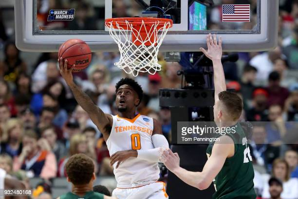 Jordan Bone of the Tennessee Volunteers goes up for a shot against Parker Ernsthausen of the Wright State Raiders in the first round of the 2018 NCAA...