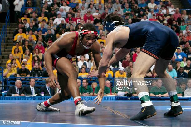 21 MARCH 2009 Jordan Borroughs of the University of Nebraska wrestles with Michael Poeta of the University of Illinois during their 157 pound...