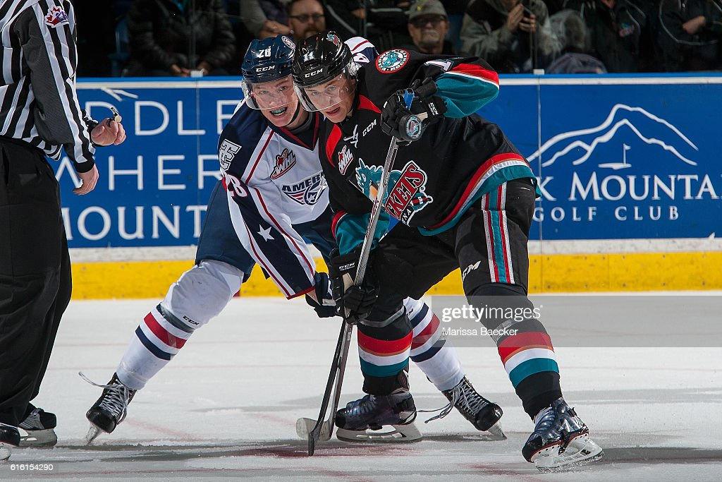 Jordan Borstmayer #11 of the Kelowna Rockets wins the face off against Morgan Geekie #28 of the Tri-City Americans on October 21, 2016 at Prospera Place in Kelowna, British Columbia, Canada.