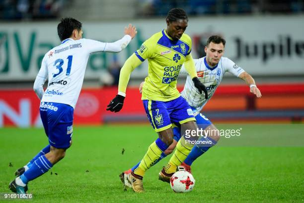 Jordan Botaka forward of STVV is challenged by Yuya Kubo forward of KAA Gent and Birger Verstraete midfielder of KAA Gent during the Jupiler Pro...