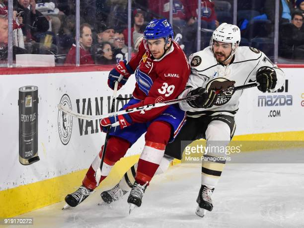 Jordan Boucher of the Laval Rocket and Connor Hobbs of the Hershey Bears skate after the puck during the AHL game at Place Bell on February 16 2018...