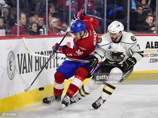 Jordan Boucher of the Laval Rocket and Connor Hobbs of the Hershey Bears chase the puck along the boards during the AHL game at Place Bell on...