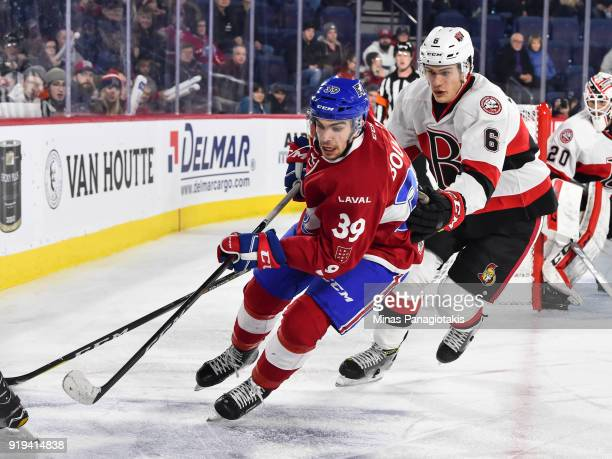 Jordan Boucher of the Laval Rocket skates against Andreas Englund of the Belleville Senators during the AHL game at Place Bell on February 14 2018 in...